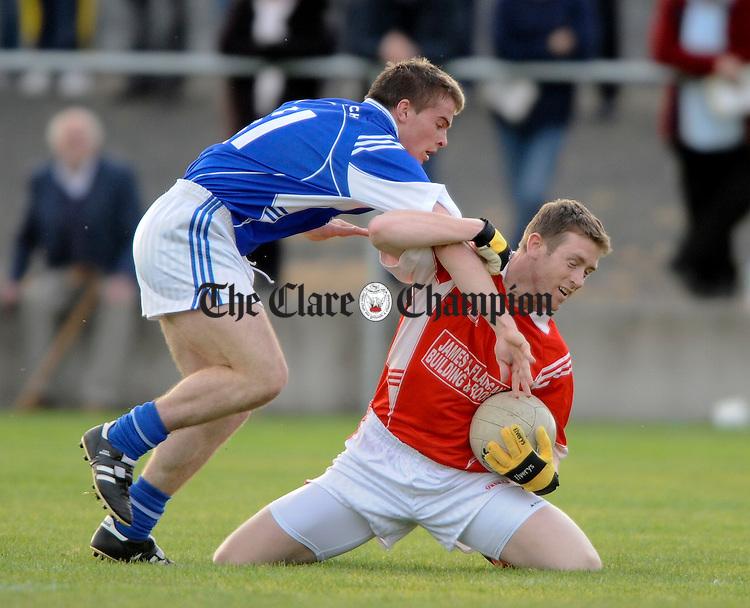 Cratloe's  Sean Collins tackles Corofins John Shannon during their Intermediate football final at Clarecastle. Photogreaph by John Kelly.