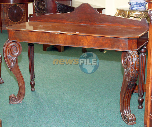 Lot 14, Regency Mahogany Sidetable, Greenes Antique Dealers...Photo NEWSFILE/Jenny Matthews.(Photo credit should read Jenny Matthews/NEWSFILE)....This Picture has been sent you under the condtions enclosed by:.Newsfile Ltd..The Studio,.Millmount Abbey,.Drogheda,.Co Meath..Ireland..Tel: +353(0)41-9871240.Fax: +353(0)41-9871260.GSM: +353(0)86-2500958.email: pictures@newsfile.ie.www.newsfile.ie.FTP: 193.120.102.198.
