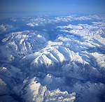 A3AAM1 Aerial view of alpine mountain peaks covered by ice and snow