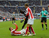 Phillip Bardsley of Stoke City clashes with Papiss Cisse of Newcastle United towards the end of the game