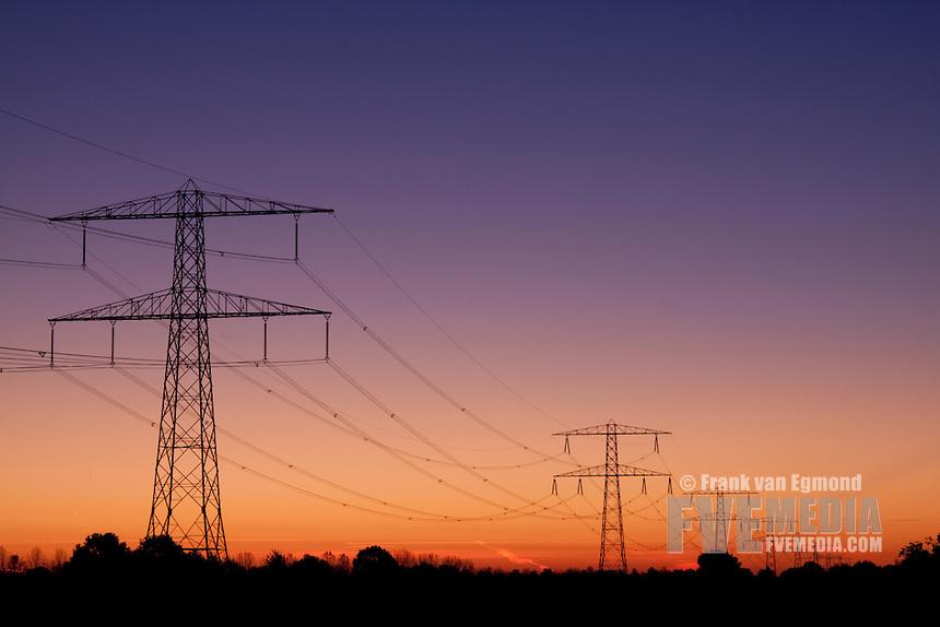 Powerline towers at dawn. Wijchen, The Netherlands.