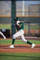 AZL Athletics Green Givaine Bisilia (1) at bat during an Arizona League game against the AZL Reds on July 21, 2019 at the Cincinnati Reds Spring Training Complex in Goodyear, Arizona. The AZL Reds defeated the AZL Athletics Green 8-6. (Zachary Lucy/Four Seam Images)