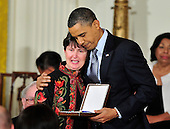 """United States President Barack Obama and first lady Michelle Obama present the 2010 Medal of Freedom, """"the Nation's highest civilian honor presented to individuals who have made especially meritorious contributions to the security or national interests of the United States, to world peace, or to cultural or other significant public or private endeavors"""", to Dr. Tom Little in a ceremony in the East Room of the White House in Washington, D.C. on Tuesday, February 15, 2011.  Dr. Little's widow, Libby, accepted the award on his behalf..Credit: Ron Sachs / CNP"""