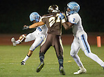 Torrance, CA 10/02/15 - Agustin Delgadillo (Carson #19) in action during the Carson-West Torrance CIF varsity football game at West Torrance High School.  Carson defeated West Torrance 34-27.