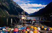 A commercial fishing boat moored at Deepwater Basin, Milford Sound, Fiordland National Park, South Island, New Zealand.