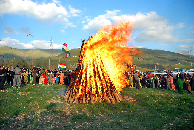 SULAIMANIYAH, IRAQ: People gather around a large bonfire in Goizha on the outskirts of Sulaimaniyah..Newroz, celebrated across the world on the vernal equinox, is the official beginning of the Kurdish calendar and the first day of spring.  Kurds celebrate Newroz on March 20th and 21st by lighting fires and performing traditional dances...Photo by Ranj Abdullah/ Metrography