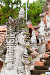 A stone statue guards the central fountain on the lower level of the famous Bramavihara-Arama Buddhist Temple, in northern Bali (Indonesia).