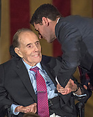 Speaker of the United States House Paul Ryan (Republican of Wisconsin), right, shakes hands with former US Senator Bob Dole (Republican of Kansas), left, prior to presenting the Congressional Gold Medal to Dole in the Rotunda of the US Capitol on Wednesday, January 17, 2017.  Congress commissioned gold medals as its highest expression of national appreciation for distinguished achievements and contributions.  Dole served in Congress from 1961 through 1996, was the Senate GOP leader from 1985 through 1996, and was the 1996 Republican Party nominee for President of the United States.  <br />
