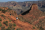 Male and female backpackers hiking down the South Kaibab Trail to the Colorado River and Phantom Ranch Campground, Grand Canyon National Park, northern Arizona, USA . John offers private photo tours in Grand Canyon National Park and throughout Arizona, Utah and Colorado. Year-round.