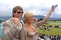 Keith and Lisa Duffy cheer ona  winner at Killarney Races on Thursday where later on they judged the Dawn Dairies Queen of Fashion.<br /> Picture by Don MacMonagle