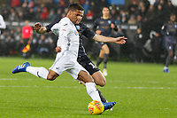 (L-R) Wayne Routledge of Swansea City prepares to cross the ball next to Tom Lees of Sheffield Wednesday during the Sky Bet Championship match between Swansea City and Sheffield Wednesday at the Liberty Stadium , Swansea, Wales, UK. Saturday 15 December 2018
