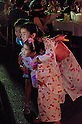 August 6th, 2011 : Tokyo, Japan - People dress up with Yukata . : Bon Dance is held at the Tsukiji Honganji every summer. Due to the conservation of electricity, this festival is supposed to be an eco bon dance.
