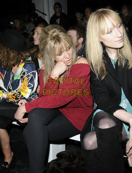 JO WOOD & JADE PARFITT .At the House of Holland a/w 2011 Fashion Show during London Fashion Week, Old Sorting Office, London, England, UK, February 19th 2011..half length red off the shoulder top black sitting front row  .CAP/CAN.©Can Nguyen/Capital Pictures.