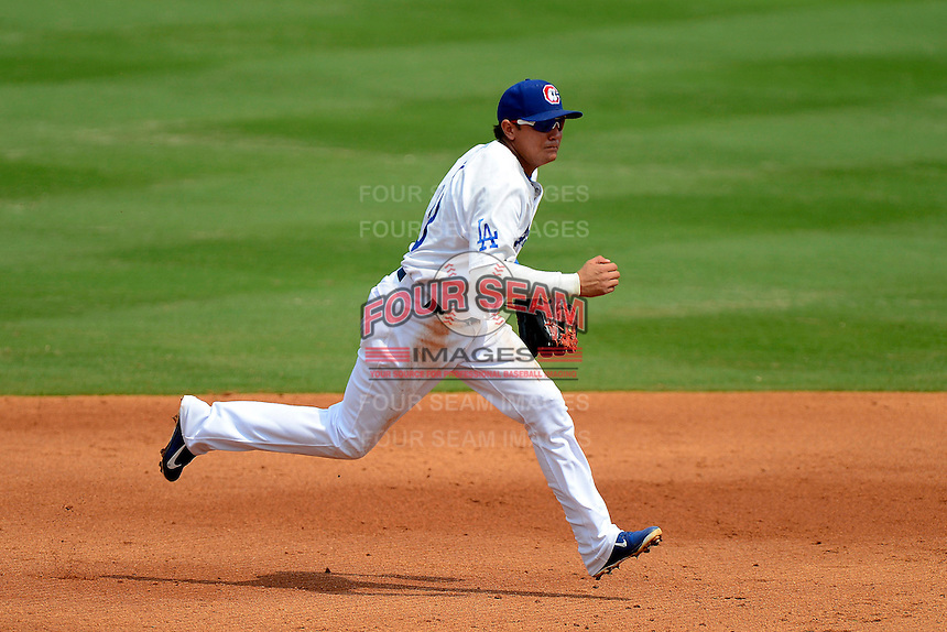 Chattanooga Lookouts shortstop Miguel Rojas #13 during a game against the Birmingham Barons on April 17, 2013 at AT&T Field in Chattanooga, Tennessee.  Chattanooga defeated Birmingham 5-4.  (Mike Janes/Four Seam Images)