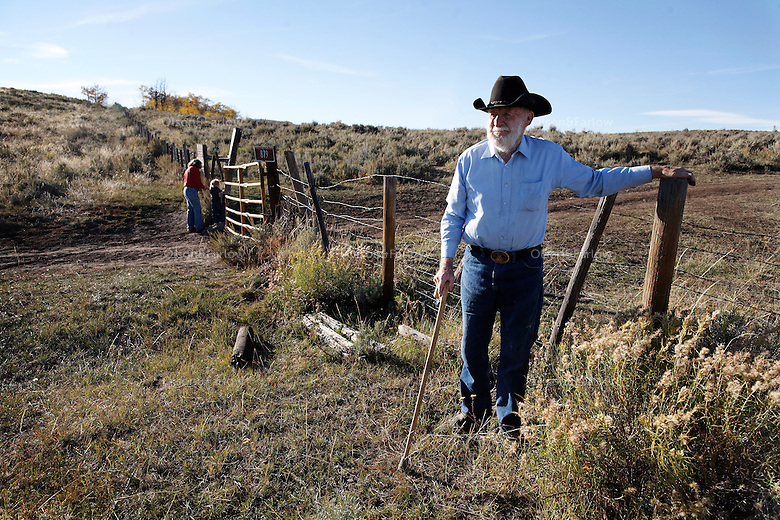 Geroge Salisbury checks the fence near the Ladder Livestock Ranch in southern Wyoming.
