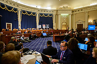 """Wide view of the hearing room as Marie """"Masha"""" Yovanovitch, former United States Ambassador to Kyiv, Ukraine, on behalf of the US Department of State, testifies during the US House Permanent Select Committee on Intelligence public hearing as they investigate the impeachment of US President Donald J. Trump on Capitol Hill in Washington, DC on Friday, November 15, 2019. Credit: Ron Sachs / CNP/AdMedia"""