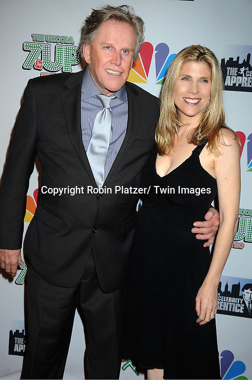 "Gary Busey and Steffanie posing for photographers at ""The Celebrity Apprentice"".Season Four Finale Party on May 22, 2011 at The Trump Soho Hotel in New York City."