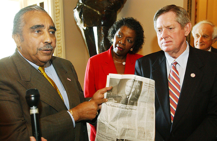 10/30/03.MEDICARE CONFERENCE--House ranking Democrat Charles B. Rangel, D-N.Y., with other Democrats, talks to  reporters after leaving the hall where Chairman Bill Thomas, R-Calif., hosts the Medicare conference in his hideaway. Thomas would not allow Rangel, who is a member of the conference, and others to attend, even though at least two Democratic senators are regular participants in negotiations. Rangel refers to today's Washington Post. Looking on are Stephanie Tubbs Jones, D-Ohio, and Marion Berry, D-Ark..CONGRESSIONAL QUARTERLY PHOTO BY SCOTT J. FERRELL