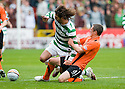 17/10/2010   Copyright  Pic : James Stewart.sct_jsp029_dundee_utd_v_celtic  .:: GEORGIOS SAMARAS IS CHALLENGED BY SCOTT SEVERIN :: .James Stewart Photography 19 Carronlea Drive, Falkirk. FK2 8DN      Vat Reg No. 607 6932 25.Telephone      : +44 (0)1324 570291 .Mobile              : +44 (0)7721 416997.E-mail  :  jim@jspa.co.uk.If you require further information then contact Jim Stewart on any of the numbers above.........