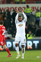Monday 16 March 2015<br /> Pictured: Swansea's Ashley Williams applauds the crowd as he leaves the field at full-time.<br /> Re: Barclay's Premier League, Swansea City FC v Liverpool at the Liberty Stadium, south Wales, UK.