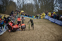 race leaders Sven Nys (BEL/Crelan-AAdrinks) & Wout Van Aert (BEL/Vastgoedservice-Golden Palace) need to deviate around the crashed Michael Vanthourenhout (BEL/Sunweb-Napoleon Games) in the last lap (while fighting for the win)<br /> <br /> Duinencross Koksijde WorldCup 2015