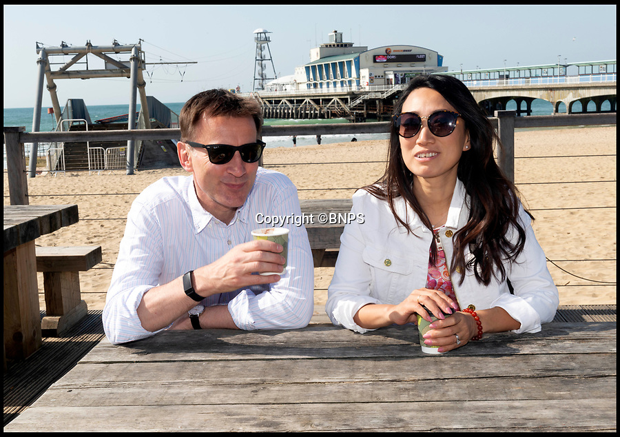 BNPS.co.uk (01202 558833)Pic:   RogerArbon/BNPS<br /> <br /> Jeremy Hunt has a coffee by the pier in Bournemouth this morning with his wife Lucia Hunt.