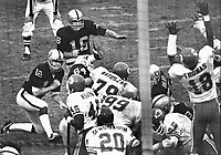 Oakland Raiders George Blanda kicks a field goal from the hold of QB Kenny Stabler..against the Kansas City Chiefs...(1975 photo/Ron Riesterer)