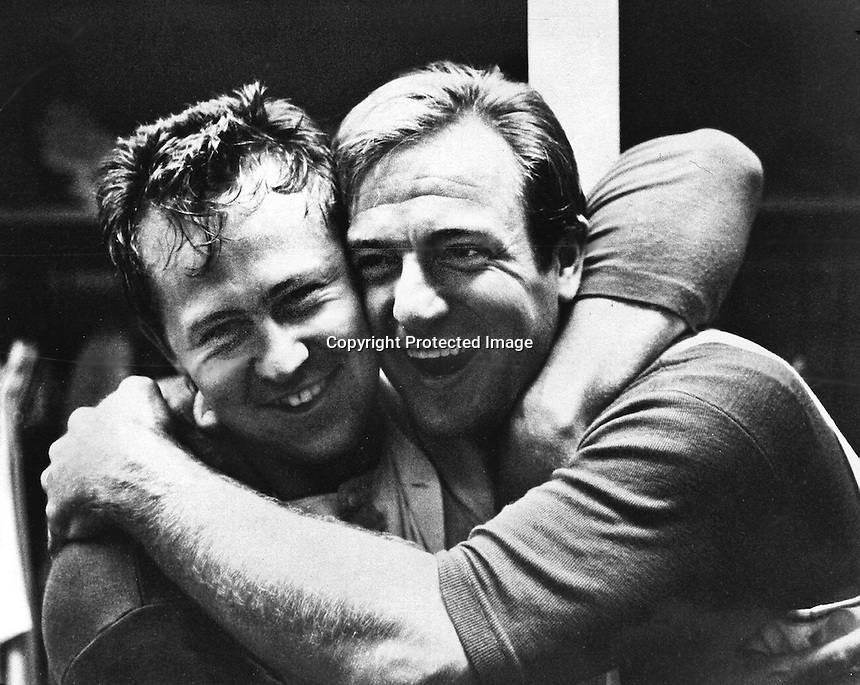 "A's pitcher Jim ""Catfish"" Hunter is hugged by his catcher Jim Pagliaroni after no-hit perfect game against the Twins in 1968. (copyright Ron Riesterer/.Oakland Tribune)"