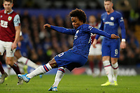 11th January 2020; Stamford Bridge, London, England; English Premier League Football, Chelsea versus Burnley; Willian of Chelsea taking a shot - Strictly Editorial Use Only. No use with unauthorized audio, video, data, fixture lists, club/league logos or 'live' services. Online in-match use limited to 120 images, no video emulation. No use in betting, games or single club/league/player publications
