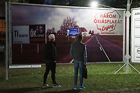 "Visitors watch a politics themed billboard reacting in Hungarian to the movie title ""Three Billboards Outside Ebbing"" at the Arc Billboard social issues exhibition in Budapest, Hungary on Sept. 24, 2018. ATTILA VOLGYI"
