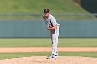 Surprise Saguaros relief pitcher Walker Sheller (49), of the Kansas City Royals organization, looks in for the sign during an Arizona Fall League game against the Salt River Rafters at Salt River Fields at Talking Stick on October 23, 2018 in Scottsdale, Arizona. Salt River defeated Surprise 7-5 . (Zachary Lucy/Four Seam Images)