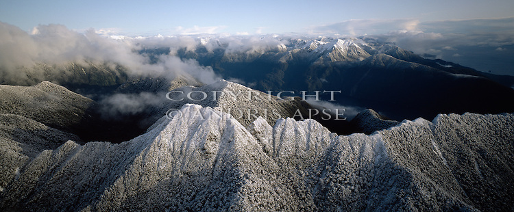 Aerial of fresh snow on mountains in Fiordland National Park. New Zealand.