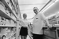 Rockford, Illinois, USA. April 1971. American figure skater World Champion Janet Lynn with her father Florian Nowicki in his pharmacy in Rockford, Illinois.