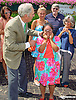 Brereton Jones helps a youngster with her new goggles that Kerwin Clark had given her in the winner's circle after Divine Excitement wins at Delaware Park on 7/11/15
