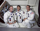 Kennedy Space Center, FL - May 22, 1968 -- The prime crew of Apollo 7, the first manned Apollo space mission, from left to right are: Command Module pilot, Don F. Eisele, Commander, Walter M. Schirra Jr. and Lunar Module pilot, Walter Cunningham. The photograph was taken inside the White Room which is attached to the crew access arm. From here astronauts ingress and egress the spacecraft. Commander Wally Schirra Jr. is seen inside the opening of the Command Module's main hatch. .Credit: NASA via CNP