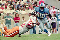Barry Sanders evades a tackler as he carries the ball, Detroit Lions at Tampa Bay Buccaneers NFL football game won by Tampa Bay 24-14 at Tampa Stadium, in Tampa , Florida on Sunday October 2, 1994 . (Photo by Brian Cleary/bcpix.com)