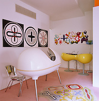 The artwork, pod-like mixing desk and desk and chair were all designed by Karim Rashid