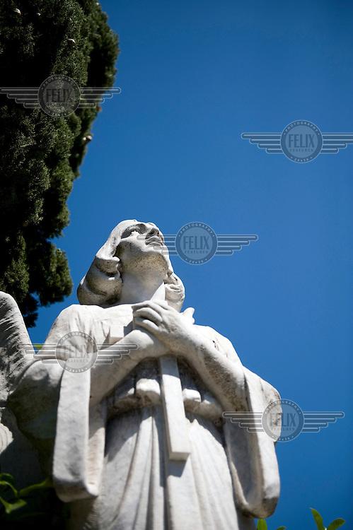 A statue in a cemetery in Trieste.