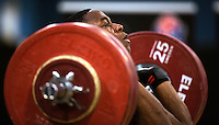 23 FEB 2014 - SMETHWICK, GBR - Alvin Ossai  attempts to complete a lift during the men's 85kg category round at the 2014 English Weightlifting Championships at the Harry Mitchell Leisure Centre in Smethwick, Great Britain (PHOTO COPYRIGHT © 2014 NIGEL FARROW, ALL RIGHTS RESERVED)