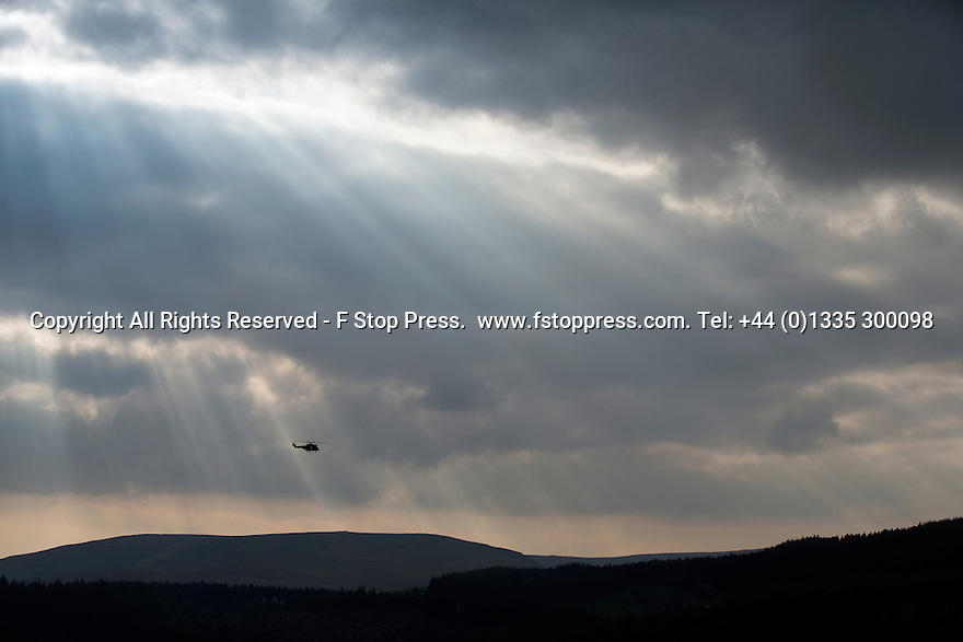 21/09/14 <br /> <br /> An RAF Puma helicopter, waits for the last two airworthy Lancaster bombers in the world  fly over Derwent Dam, in the Derbyshire Peak District, echoing the famous Dambusters raid practised there.<br /> <br /> One of the Lancasters is normally based in Canada, but has been reunited with her Lincolnshire sister for a series of events in the UK.<br /> <br /> The Derwent flypast is partly a tribute to the Canadian men who gave their lives in World War Two.<br /> <br /> <br /> <br /> All Rights Reserved - F Stop Press.  www.fstoppress.com. Tel: +44 (0)1335 300098