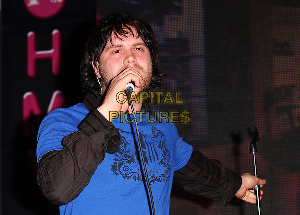DANIEL BEDINGFIELD .Performing & Signing His New Album At HMV Oxford Street, London.October 8th, 2004.half length, singing, microphone, blue t shirt, t-shirt.www.capitalpictures.com.sales@capitalpictures.com.© Capital Pictures.