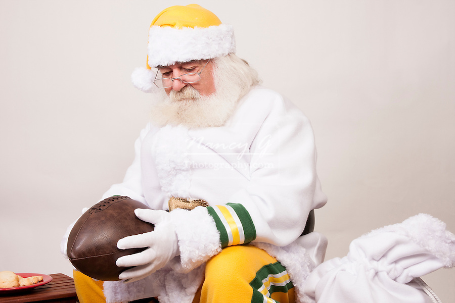A Green and Gold Santa Claus with a football