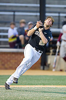 Wake Forest Demon Deacons third baseman Will Craig (22) catches a pop fly in the infield during the game against the Florida State Seminoles at Wake Forest Baseball Park on April 19, 2014 in Winston-Salem, North Carolina.  The Seminoles defeated the Demon Deacons 4-3 in 13 innings.  (Brian Westerholt/Four Seam Images)