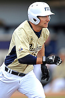 4 March 2012:  FIU infielder/outfielder Tyler James Shantz (5) runs to first as the FIU Golden Panthers defeated the Brown University Bears, 8-3, at University Park Stadium in Miami, Florida.