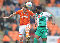 Blackpool's Harry Pritchard under pressure from Plymouth Argyle's Yann Songo'o<br /> <br /> Photographer Kevin Barnes/CameraSport<br /> <br /> The EFL Sky Bet League One - Blackpool v Plymouth Argyle - Saturday 30th March 2019 - Bloomfield Road - Blackpool<br /> <br /> World Copyright © 2019 CameraSport. All rights reserved. 43 Linden Ave. Countesthorpe. Leicester. England. LE8 5PG - Tel: +44 (0) 116 277 4147 - admin@camerasport.com - www.camerasport.com