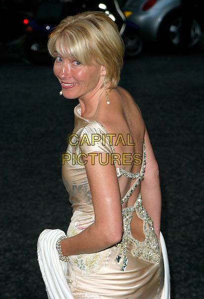 EMMA THOMPSON .The Glamour Magazine 3rd Annual Women Of The Year Awards - Arrivals, Berkeley Square, London, England, .June 6th 2006..half length gold satin patterned dress wrap shawl looking back over shulder jewelled .REf: AH.www.capitalpictures.com.sales@capitalpictures.com.©Adam Houghton/Capital Pictures.