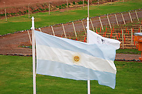 View of the vineyards showing the red soil that has given the name to the winery. Argentinean flag Bodega Del Anelo Winery, also called Finca Roja, Anelo Region, Neuquen, Patagonia, Argentina, South America