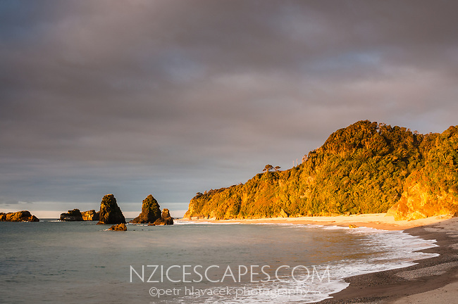 Sunset on remote, wild beach in South Westland, West Coast, New Zealand