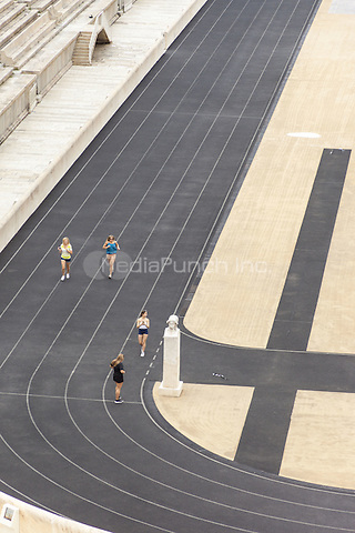 Young women running in the Panathenaic Stadium, original modern day Olympic Stadium, Athens, Greece <br /> CAP/MEL<br /> &copy;MEL/Capital Pictures /MediaPunch ***NORTH AND SOUTH AMERICA ONLY***