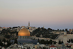 Israel, Jerusalem, the Dome of the Rock at twilight, Mount of Olives is in the background